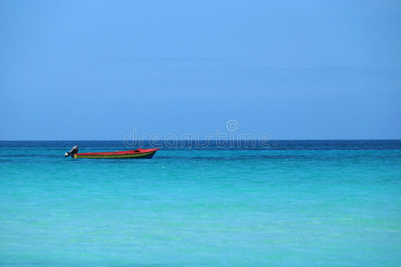 Small boat in carribean sea. stock photography