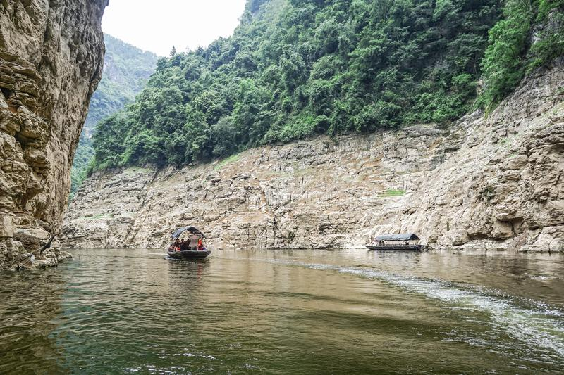 The Three Gorges Yangtze River. Small boat cruising over the Mini Three Gorges Tribe Scenic Spot at Yangtze River, China stock photography
