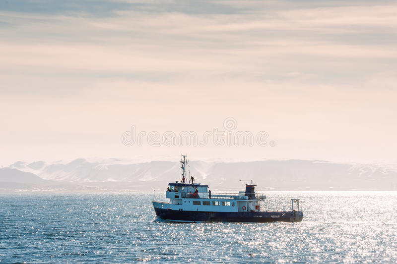 Small boat going out to sea in Reykjavik, Iceland royalty free stock photography