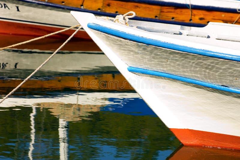 Small boat in harbor stock photo