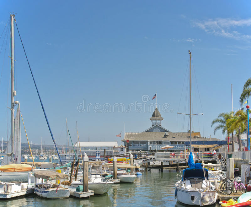Small Boat Harbor, Newport Beach, California. A small boat harbor on Newport Bay is filled with motorboats and sailboats, in front of the historic Balboa stock images