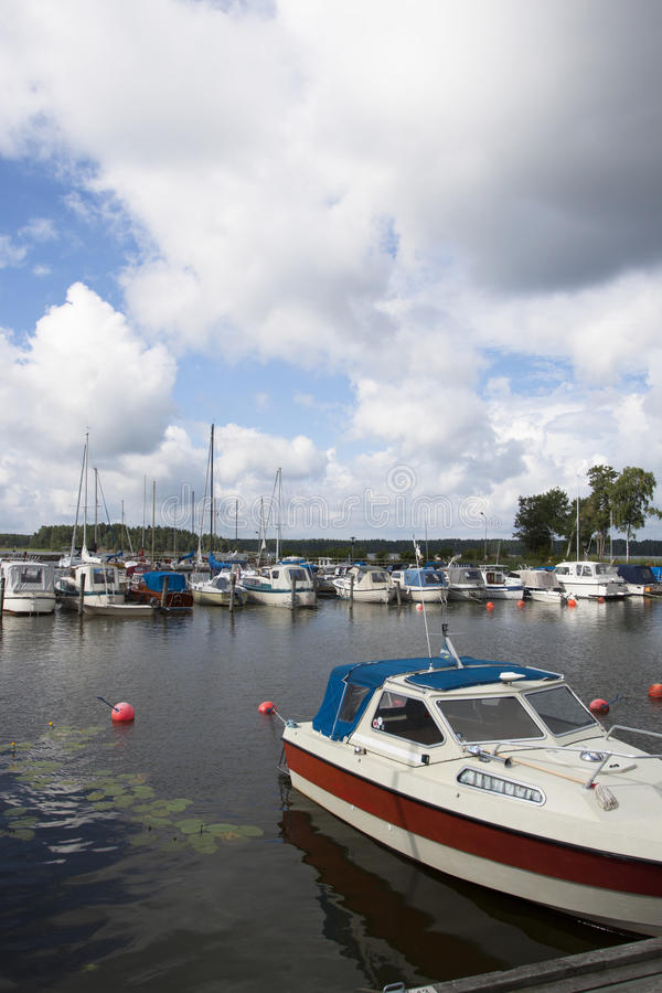 Download Small boat harbor stock image. Image of vertical, cloudy - 33054291