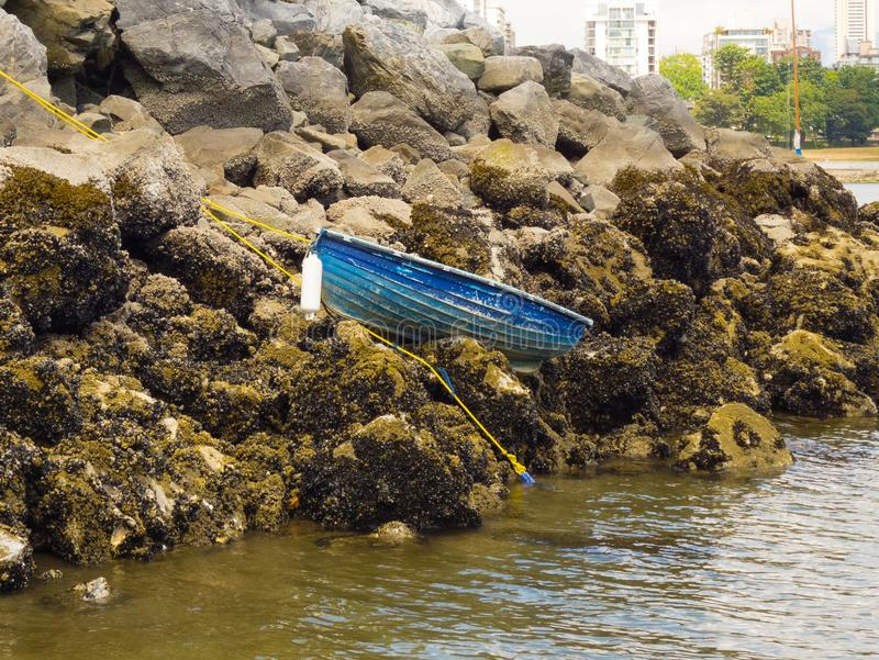 A small boat high and dry at low tide in vancouver royalty free stock image