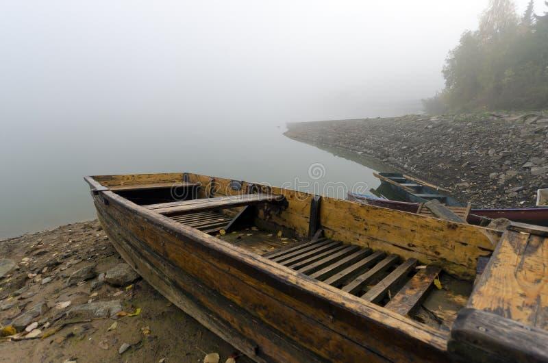 Small boat on the lake shore royalty free stock photo