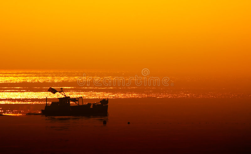 Small boat late at night stock image