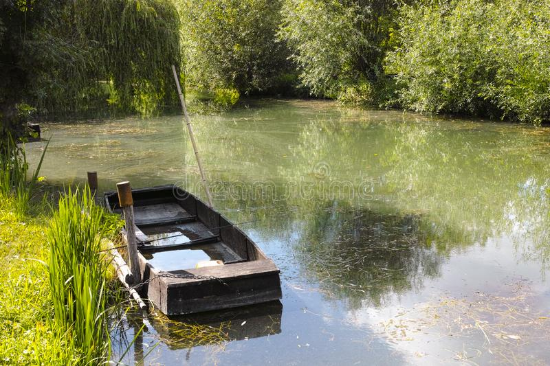 Small boat in marshes in Bourges. Berry province, Centre-Val de Loire, France royalty free stock images