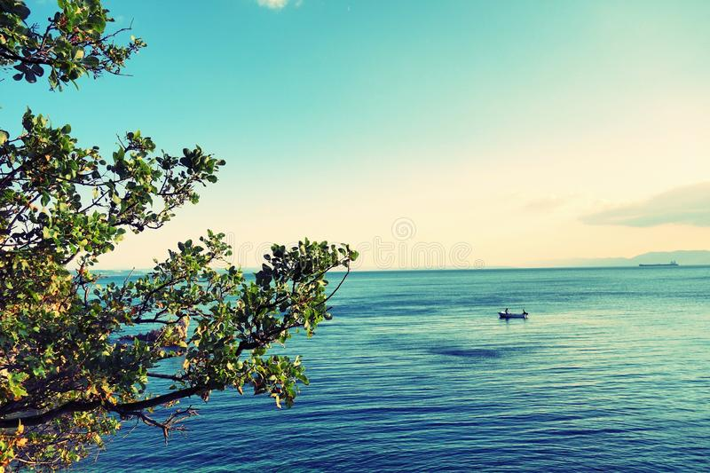 Small boat in the middle of the sea stock image
