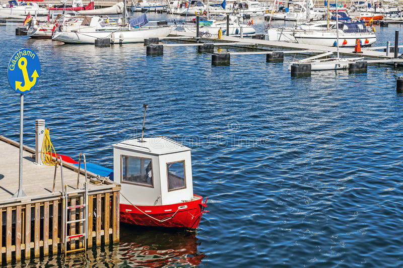 Small boat. Moored in Ystad Marina being a part of the Port of Ystad, Sweden's third-largest cargo and ferry port, serving over 1.7 million travelers per year stock photos