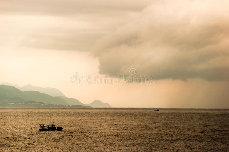 A Small Boat In The Ocean Stock Images