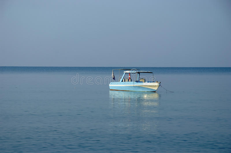 Small boat in sea stock images