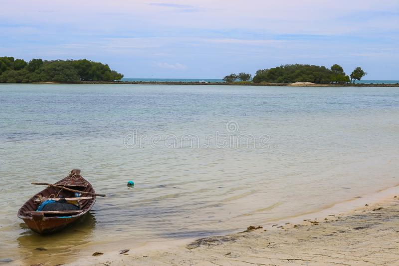 A small boat in the sea. stock image