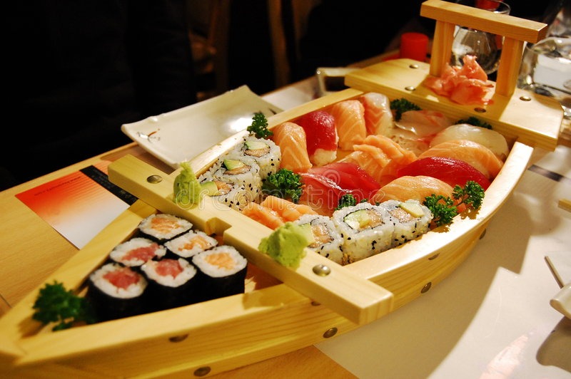 Small boat with sushi v3 royalty free stock photo