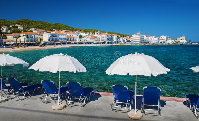 Small boat-  taxi connect island Hydra  with mainland Greece. Spetses  Island. Idyllic  morning Summer .people soon coming to the  beach   and  to this places royalty free stock photo