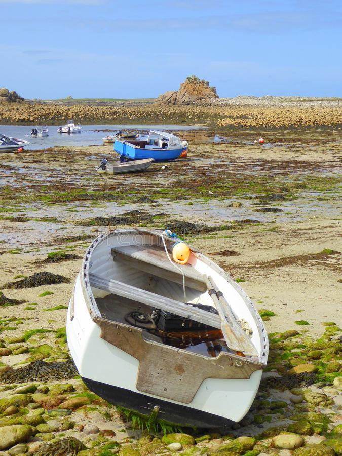 Small boats on beach at low tide stock photography