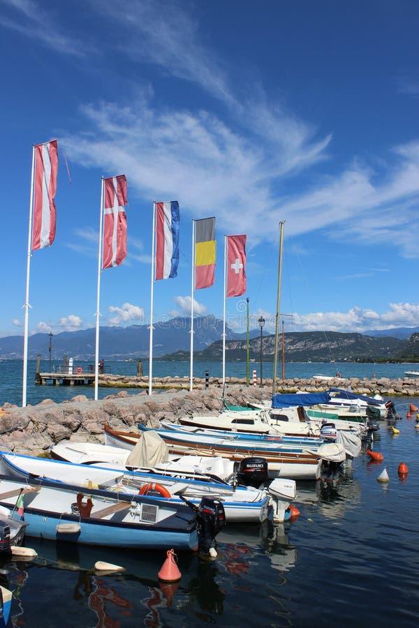 Small boats in Cisano harbor, Lake Garda, Italy stock photos