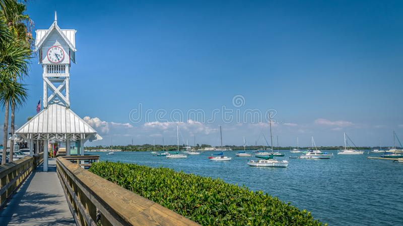 Small boats docked next to the historic Bradenton Beach pier on Anna Maria island stock photography