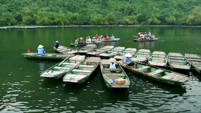 Boats join each other on the green river stock photography