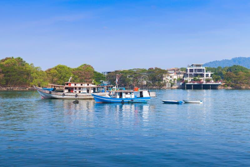Small boats. Kota Kinabalu, Malaysia. Coastal landscape with small fishing boats. Kota Kinabalu, Malaysia royalty free stock images