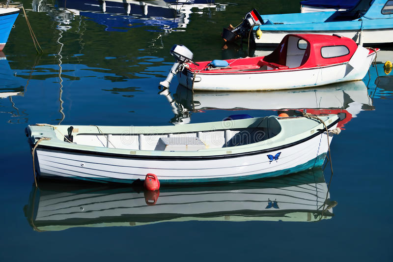 Small Boats At Lyme Regis Harbour stock photo
