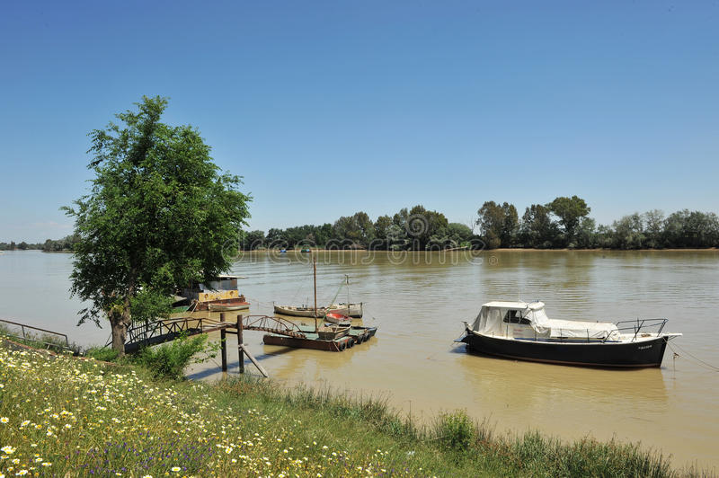 Small boats at the pier, the Guadalquivir River as it passes through Coria del Rio, Seville province, Andalusia, Spain. Fishing boats and barges on the River stock photo