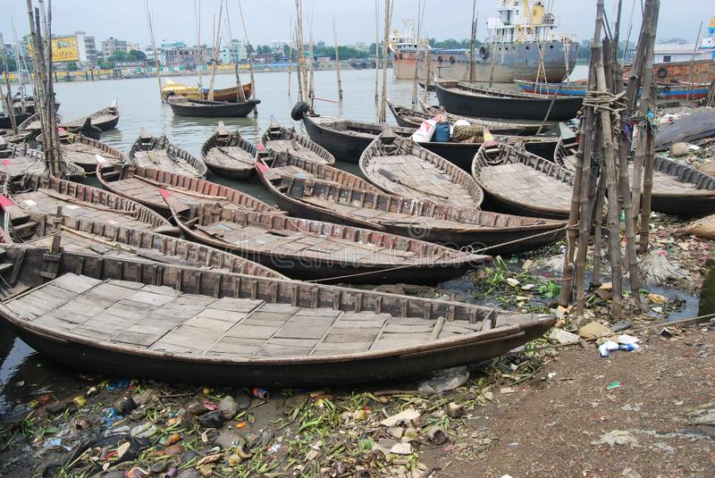 Small boats ply on the Buriganga at Sadarghat. The Buriganga is economically very important to Dhaka. Launches and country boats provide connection to other royalty free stock image