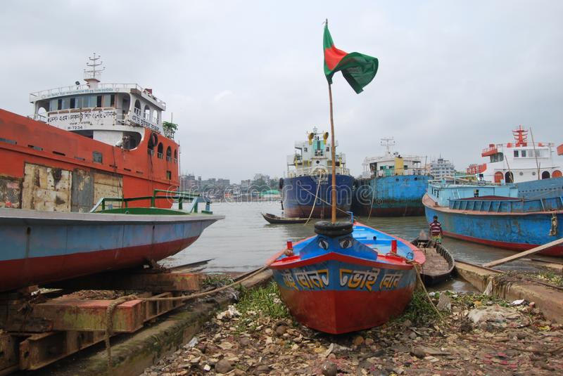 Small boats ply on the Buriganga at Sadarghat. The Buriganga is economically very important to Dhaka. Launches and country boats provide connection to other royalty free stock photography