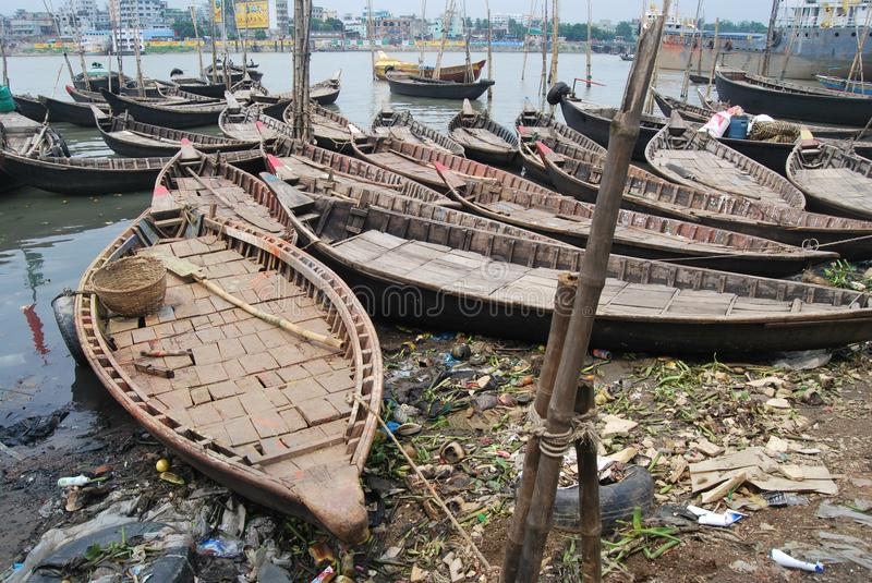 Small boats ply on the Buriganga at Sadarghat. The Buriganga is economically very important to Dhaka. Launches and country boats provide connection to other royalty free stock photo