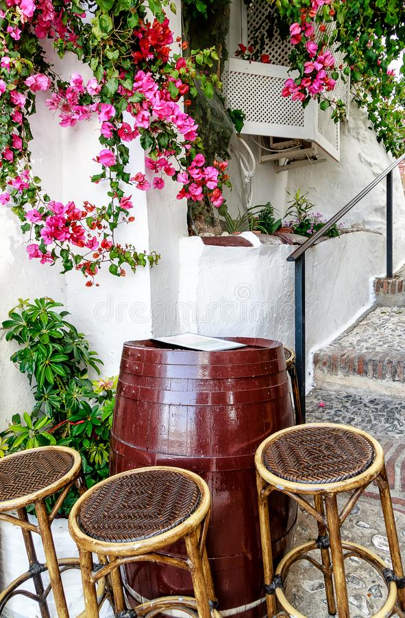 A small bodega in a steep alley of Frigiliana, one of Andalucia`s famous `White Villages` on the Costa del Sol in Southern Spain. stock photography