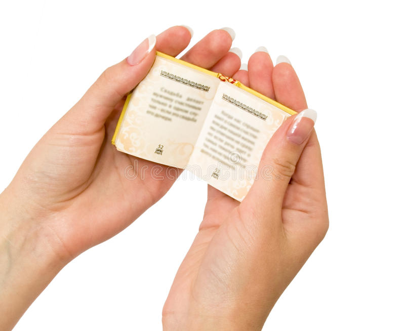 Small book in his hands stock image