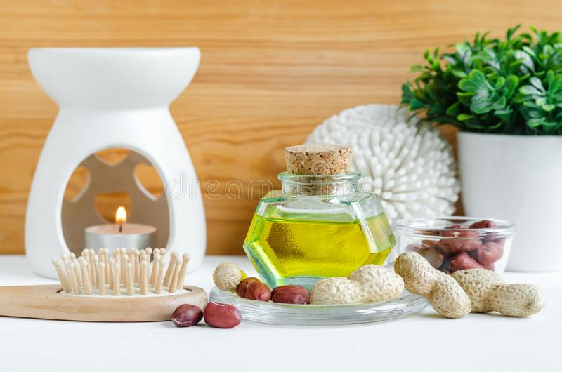 Small bottle with peanut groundnut oil for natural skin and hair care. Natural skincare concept. Copy space. Small bottle with peanut groundnut oil for natural stock images