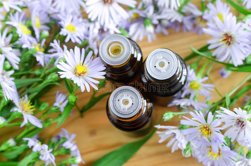 Small bottles of essential aroma oil (herbal extract, tincture, infusion). Close up, top view, copy space. royalty free stock image