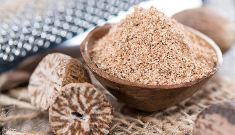 Small bowl with Nutmeg Powder. Small bowl with fresh grated Nutmeg Powder royalty free stock photos