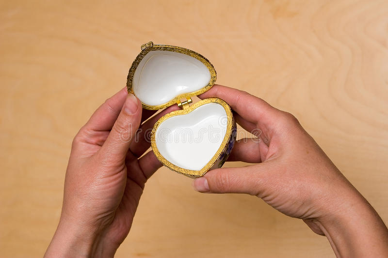 Small box. Little box for valuables as a heart in a hand stock images