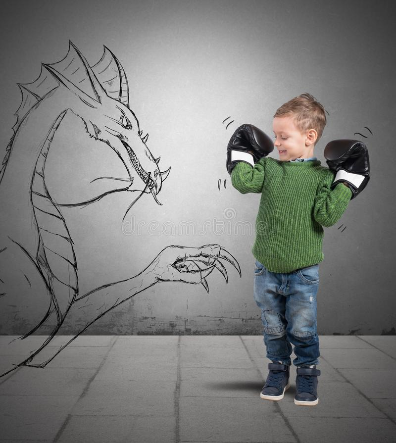 Small boxer. Plays to defeat a dragon royalty free stock images