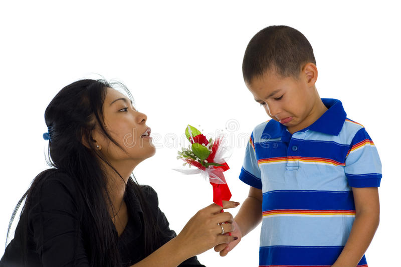 Small boy apologising to his mother royalty free stock photos