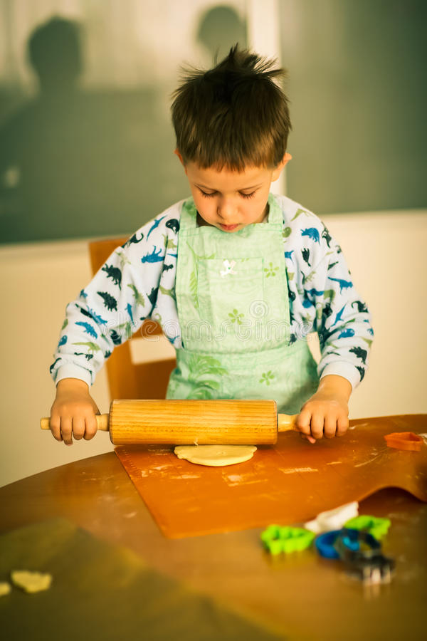 Free Small Boy Baking Cookies Royalty Free Stock Photo - 27688775