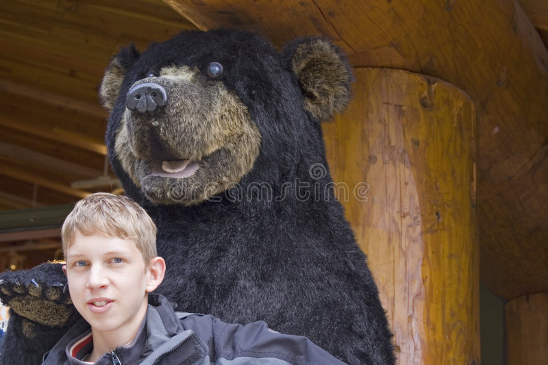 Small boy and big bear. Jasper,canada - adobe RGB stock image