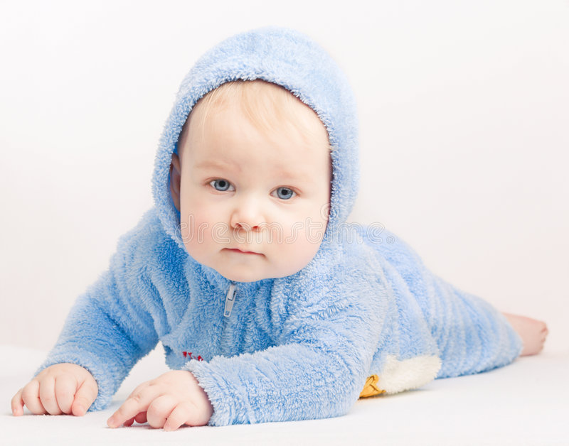 Small boy in blue overalls stock photos