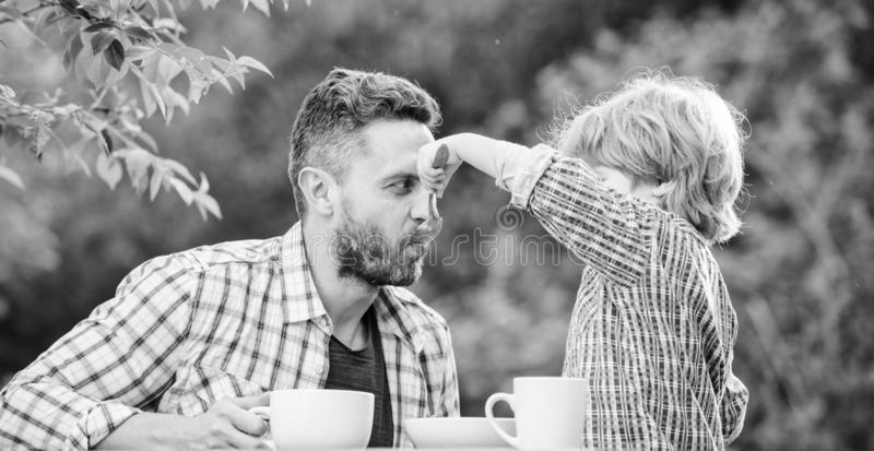 Small boy child with dad. they love eating together. Weekend breakfast. father and son eat outdoor. organic and natural royalty free stock photos