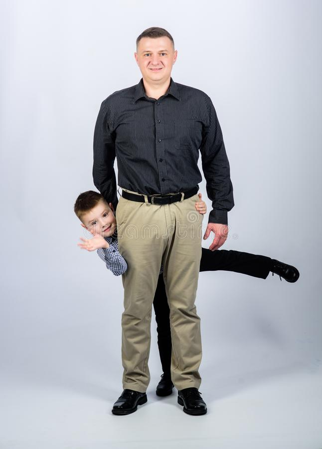 Small boy with dad businessman. happy child with father. business partner. family day. childhood. trust and values. Fathers day. father and son in business royalty free stock photography
