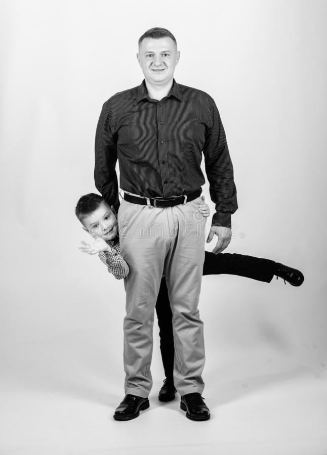 Small boy with dad businessman. happy child with father. business partner. family day. childhood. trust and values stock image