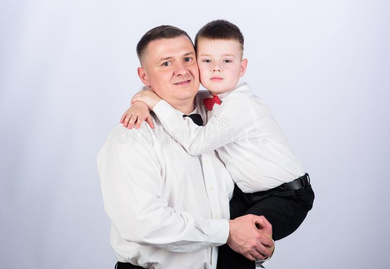 Small boy with dad gentleman. family day. happy child with father. business meeting. male fashion. parenting. fathers. Day. father and son in formal suit stock photos