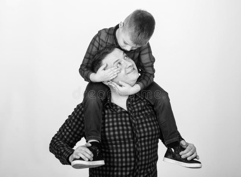 Small boy with dad man. fathers day. Enjoying time together. Happy family together. childhood. parenting. father and son. In red checkered shirt. Creating new stock photography