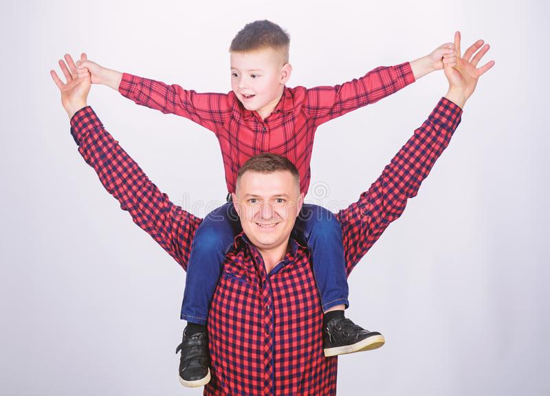 Small boy with dad man. Happy family together. childhood. parenting. fathers day. Enjoying time together. father and son. In red checkered shirt. Searching for stock photo