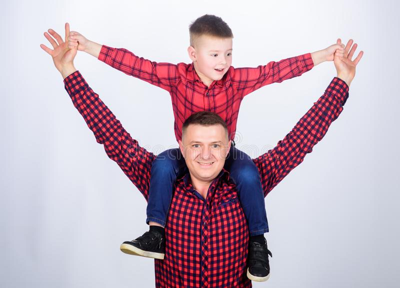 Small boy with dad man. Happy family together. childhood. parenting. fathers day. Enjoying time together. father and son. In red checkered shirt. Searching for royalty free stock photo