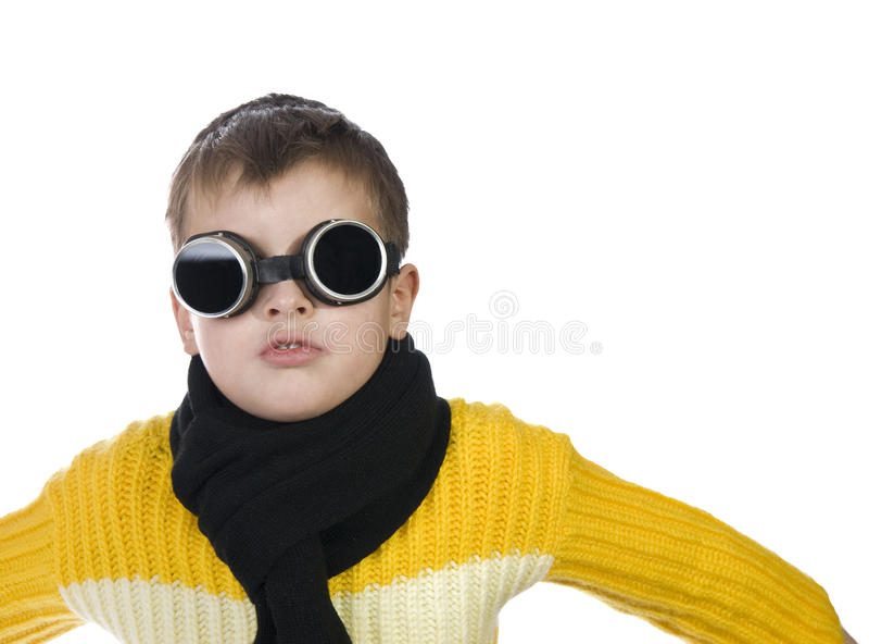 Small boy in dark glasses pretends to be a pilot