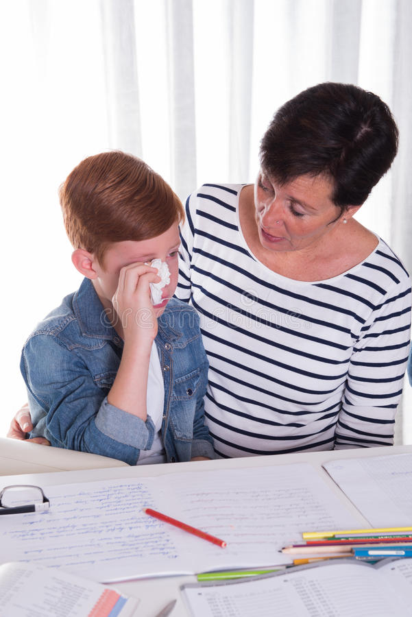 Small boy gets comforted by mother stock photos