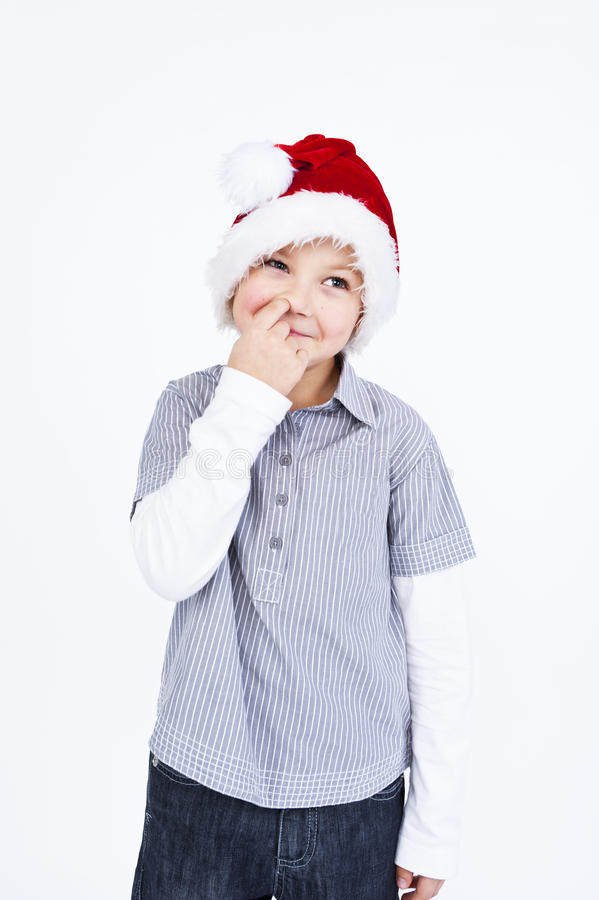Download Small Boy In Hat Picking His Nose Stock Photo - Image: 23352526