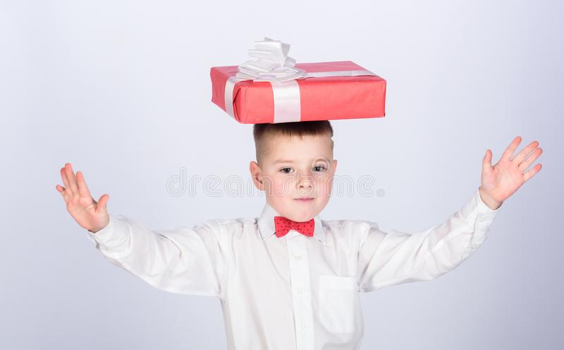 Small boy hold gift box. Christmas or birthday gift. Dreams come true. Buy gifts. Happiness and positive emotions royalty free stock photography