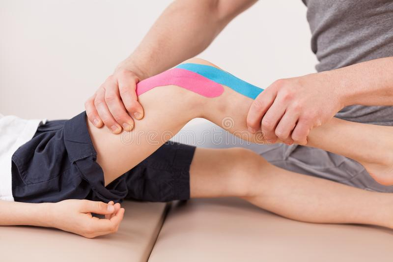Small boy with kinesio tape stock images